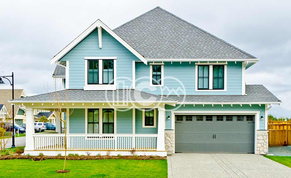 Turquoise home in residential neighborhood.