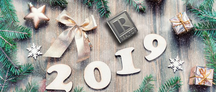 New Year 2019 background with 2019 figures, Christmas toys, green fir tree branches and snowflakes. New Year 2019 still life in retro tones. 2019 New year holiday card