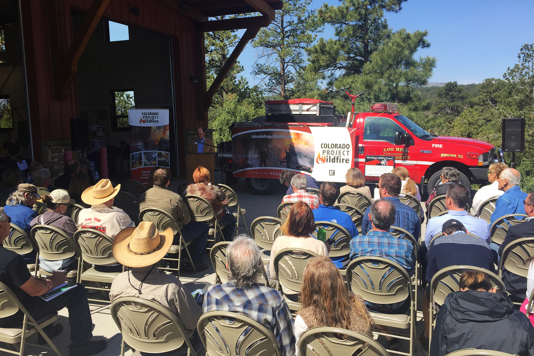 Image of Past President Alan Lovitt presenting at a Colorado Project Wildfire event