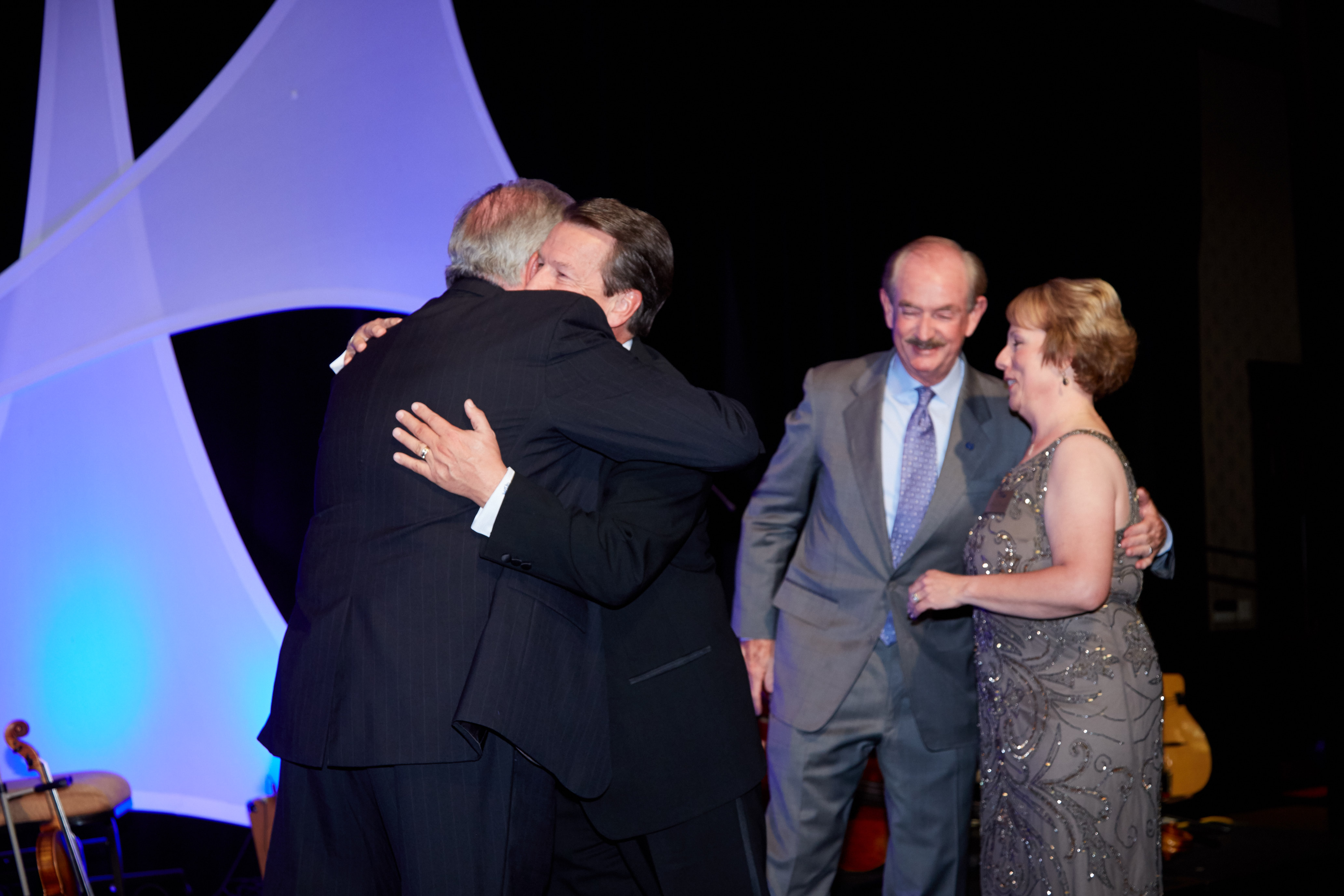 Photo of Scott Matthias accepting a REALTOR of the YEAR Award