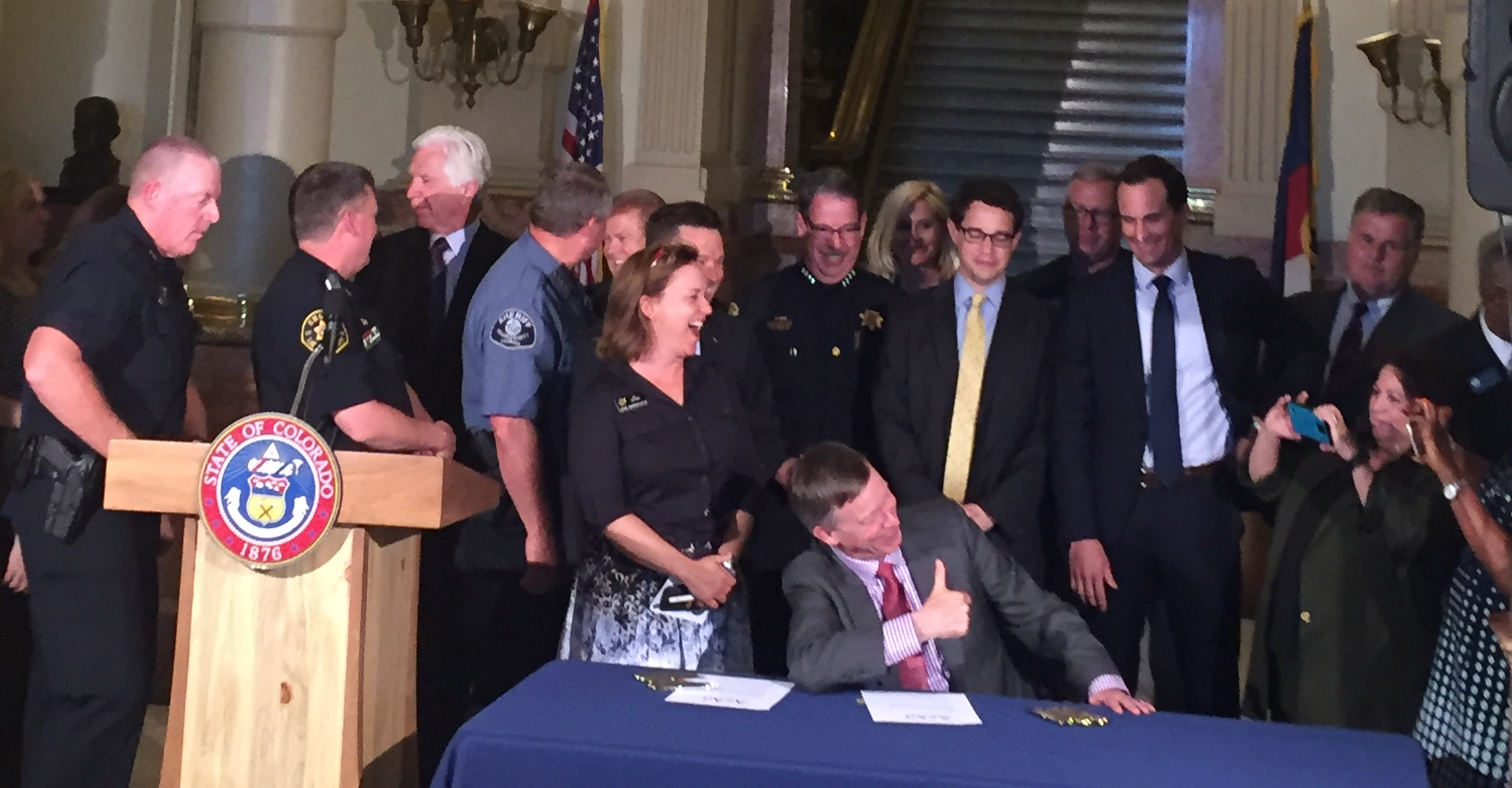 Governor Hickenlooper Gives Thumbs Up at Bill Signing