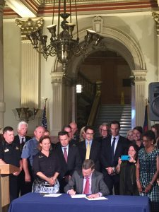 Governor Hickenlooper signs HB-1220 and HB-1221 into law with Majority Leader, K.C. Becker, and representatives from a diverse range of stakeholders who support limiting marijuana plant counts and diversion to the illegal market including Janene Johnson who represented the Colorado Association of REALTORS®.