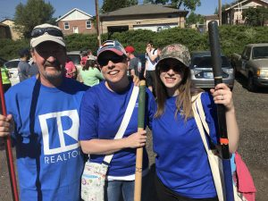 Members of CAR and Colorado Association of REALTORS Foundation helped serve a homeowner in the community with fixing their fence.