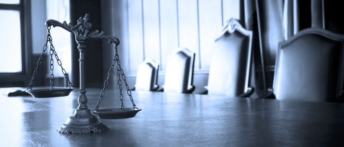 Symbol of law and justice in the empty courtroom law and justice concept BLUE TONE