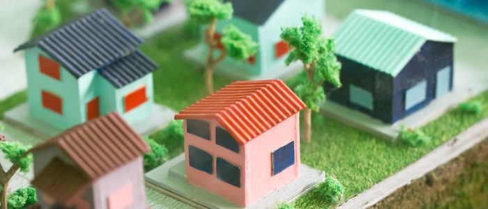 Small Homes And Trees Models On Grass.