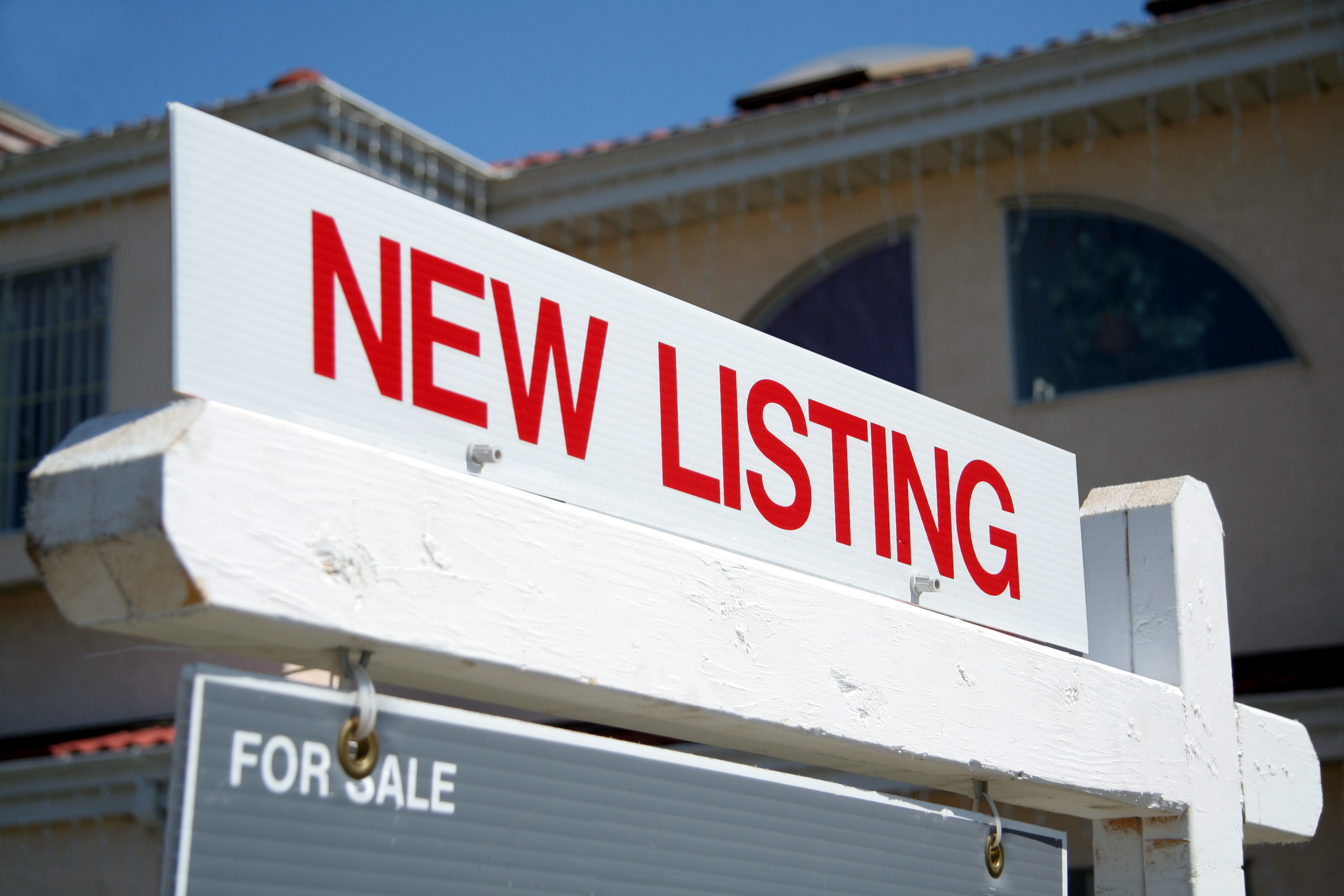 Real Estate red New Listing sign