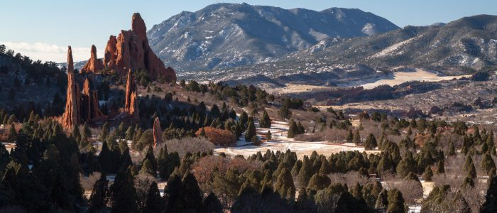 Cathedral Spires, Three Graces and Sleeping Giant rocks in Garden of the Gods, with Cheyenne Mountain in the background. Colorado Springs, Colorado