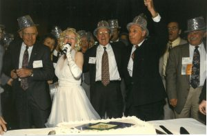 Bill Moore and a group of people wearing fun hats and celebrating!