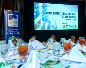 Economic Summit and REALTOR Day at the Capitol lunch setting and slideshow